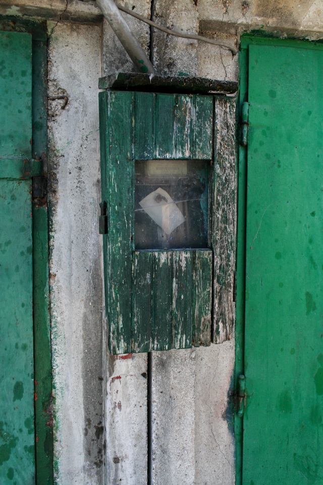 Green metal doors closeup