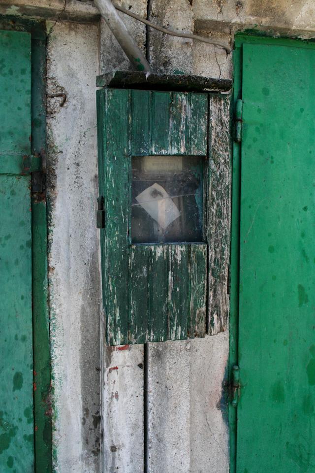 Green metal doors closeup