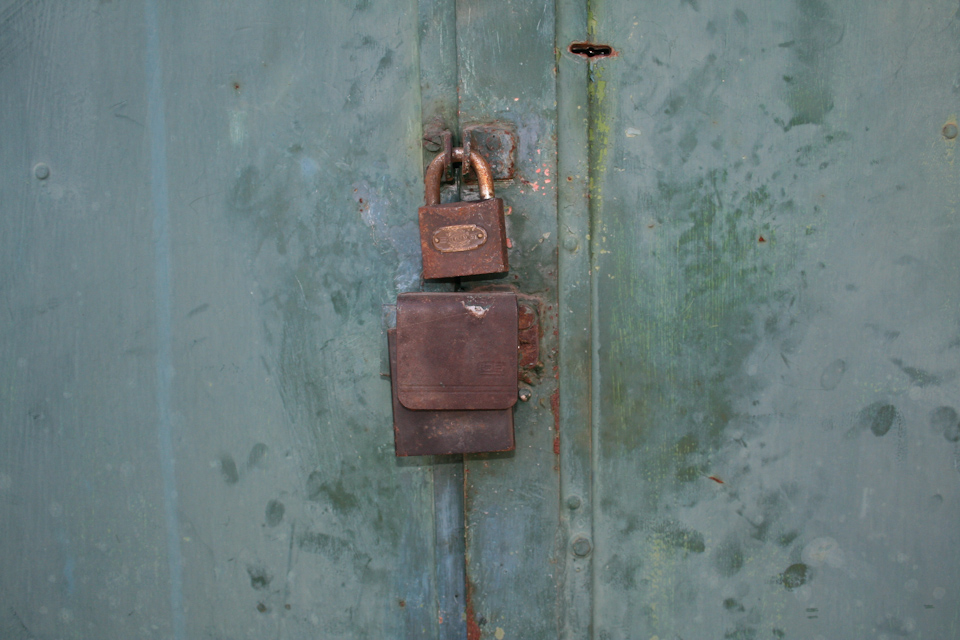 Green metal texture with padlock
